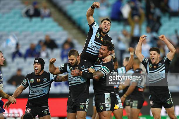 Michael Ennis Wade Graham Jack Bird Andrew Fifita and Chad Townsend of the Sharks celebrate victory during the round 13 NRL match between the...