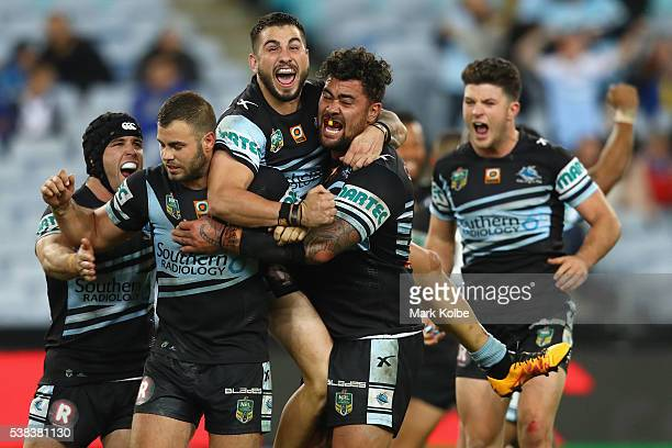 Michael Ennis, Wade Graham, Jack Bird, Andrew Fifita and Chad Townsend of the Sharks celebrate victory during the round 13 NRL match between the...
