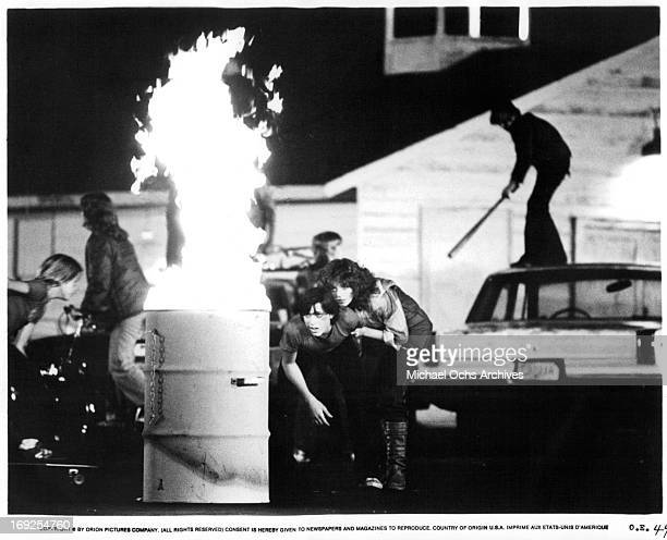 Michael Eric Kramer and Pamela Ludwig watch a fire burn in a scene from the film 'Over The Edge' 1979