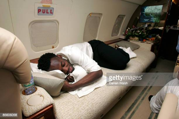 Michael Essien gets some sleep on a private jet returning from Ghana after the African Player of the Year awards which Didier Drogba won and Essien...