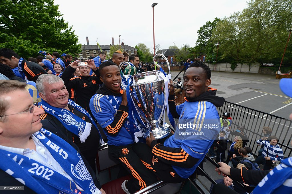 Michael Essien R Holds The Champions League Trophy During Chelsea Victory Parade Following