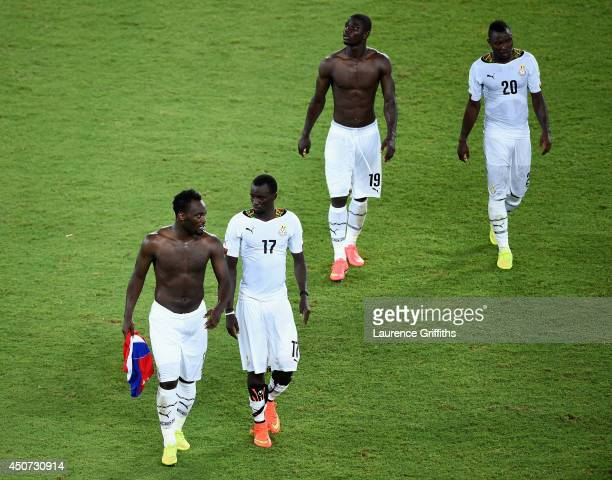 Michael Essien, Mohammed Rabiu, Jonathan Mensah and Kwadwo Asamoah of Ghana look dejected after being defeated 2-1 by the United States during the...