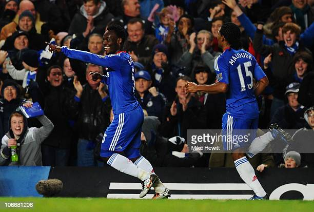 Michael Essien of Chelsea celebrates with Florent Malouda as he scores their first goal during the Barclays Premier League match between Chelsea and...