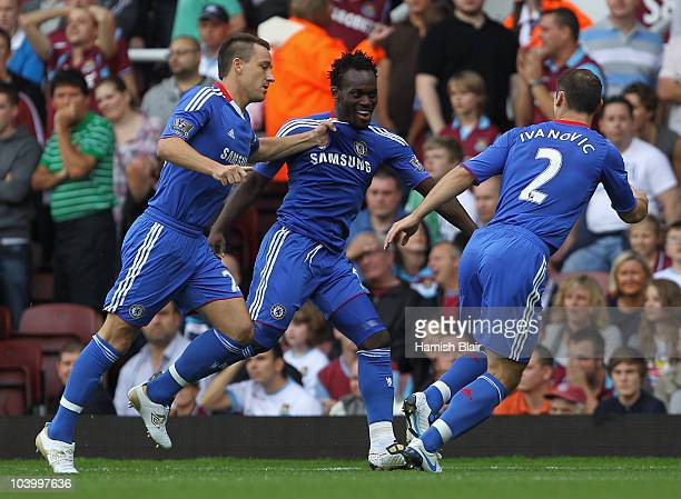 Michael Essien of Chelsea celebrates with John Terry and Branislav Ivanovic as he scores their first goal during the Barclays Premier League match...