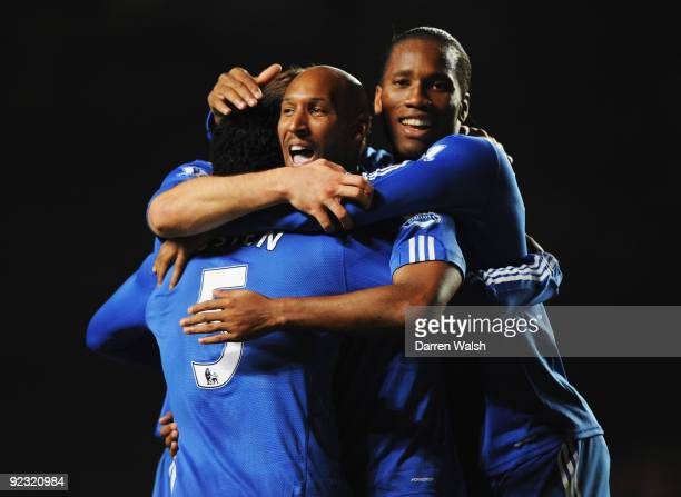 Michael Essien of Chelsea celebrates with Nicolas Anelka and Didier Drogba as he scores their third goal during the Barclays Premier League match...