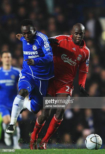 Michael Essien of Chelsea challenges Momo Sissoko of Liverpool during the Carling Cup Quarter Final match between Chelsea and Liverpool at Stamford...