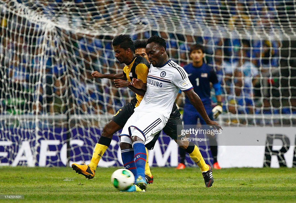 Michael Essien of Chelsea FC shields the ball from K. Gurusamy of Malaysia durng the match between Chelsea and Malaysia XI on July 21, 2013 at the Shah Alam Stadium, Kuala Lumpur, Malaysia.