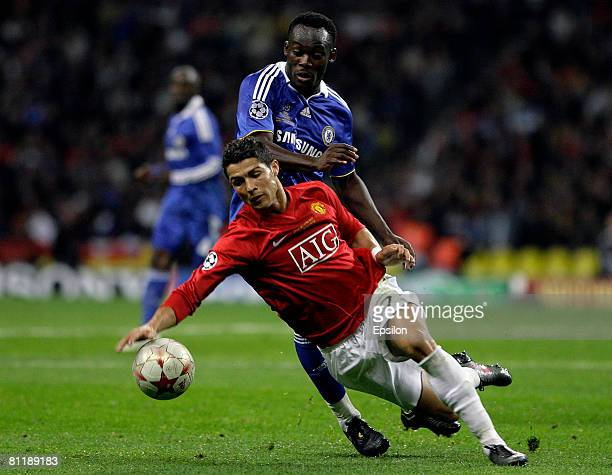 Michael Essien of Chelsea fights for the ball with Cristiano Ronaldo of Manchester United during the UEFA Champions League Final match between...