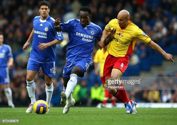 Michael Essien of Chelsea is challenged by Gavin Mahon of Watford during the Barclays Premiership match between Chelsea and Watford at Stamford...