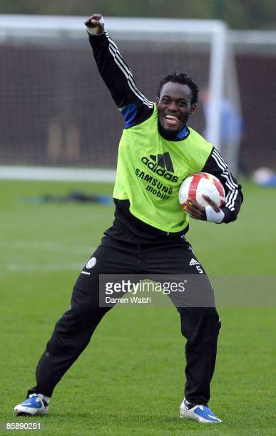 Michael Essien of Chelsea smiles during a training session at the Chelsea training ground on April 10 2009 in Cobham Surrey