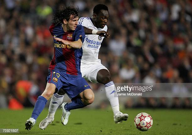 Michael Essien of Chelsea tackles Lionel Messi of Barcelona during the UEFA Champions League Group match between Barcelona and Chelsea at the Nou...