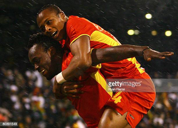 Michael Essien of Ghana celebrates with team mate Andre Ayew after he scored his teams first goal during the International Friendly match between...
