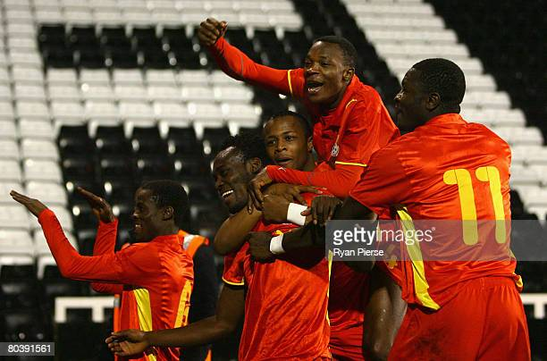 Michael Essien of Ghana celebrates with teammates after scoring his team's first goal during the international friendly match between Ghana and...