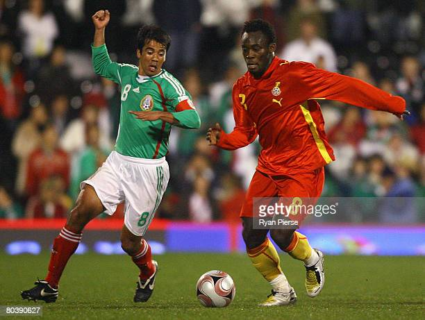 Michael Essien of Ghana competes for the ball against Pavel Pardo of Mexico during the International Friendly match between Ghana and Mexico at...