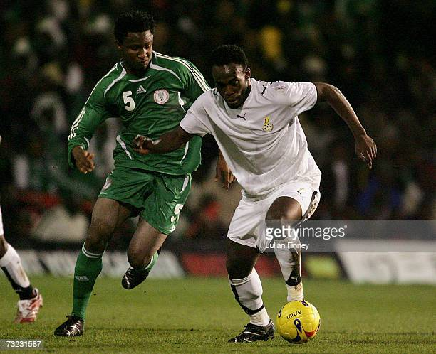 Michael Essien of Ghana holds off Obij Mikel of Nigeria during the International friendly match between Nigeria and Ghana at Griffin Park on February...