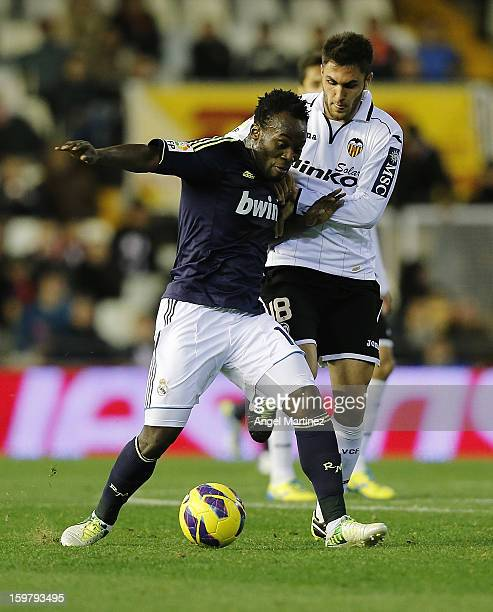 Michael Essien of Real Madrid competes for the ball with Victor Ruiz of Valencia during the La Liga match between Valencia CF and Real Madrid at...