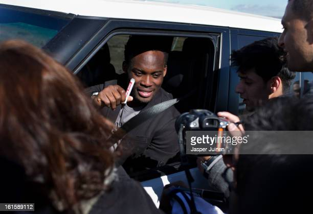 Michael Essien of Real Madrid signs autographs to fans waiting outside the Real Madrid training ground after a training session ahead of the UEFA...