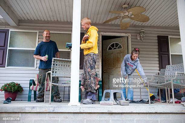 Michael Estep his son Jobe and Jobe's livein girlfriend Kristen Goodman prepare to settle in on their front porch where they spend a lot of time...
