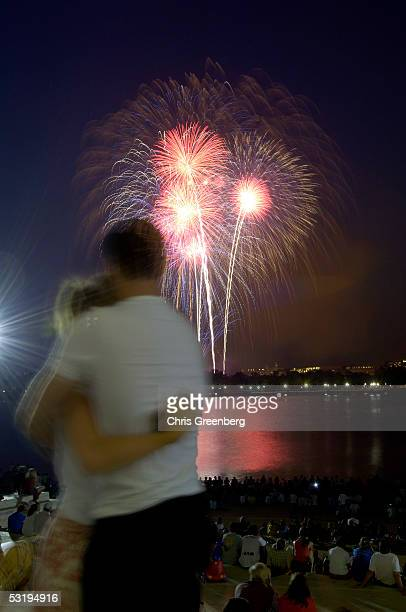 Michael Evans of Houston TX hugs Lauren Gannon of Findley OH after proposing to her on the steps of the Jefferson Memorial during the annual Fourth...