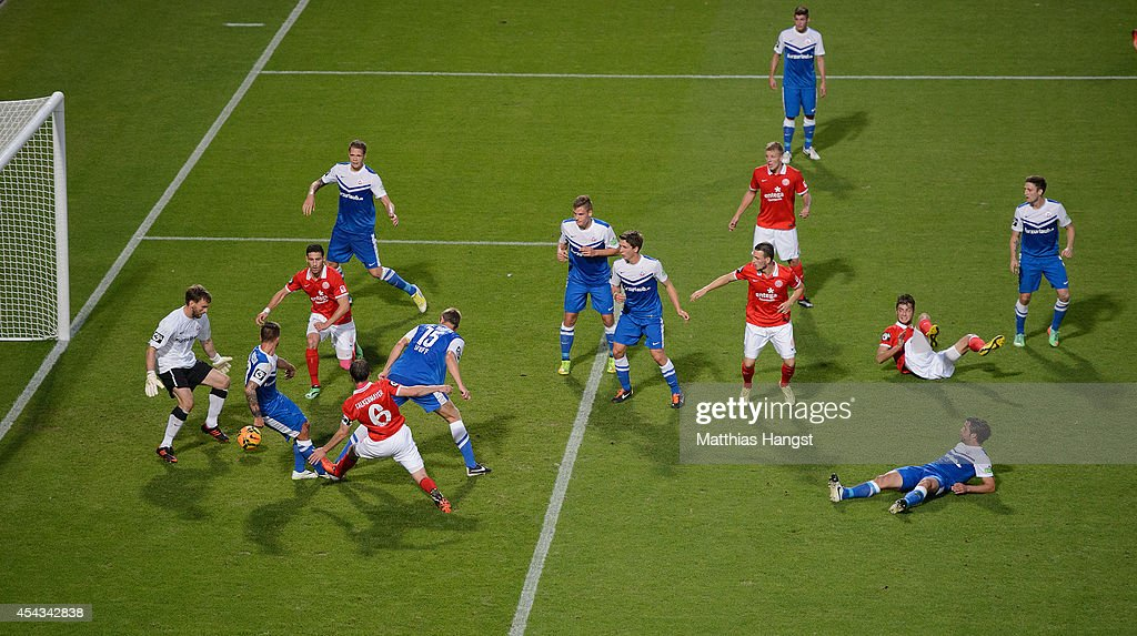 Michael Falkenmayer (6) of Mainz misses to score against Goalkeeper Joerg Hahnel (L) of Rostock during the Third league match between 1. FSV Mainz 05 II and Hansa Rostock at Bruchweg Stadium on August 29, 2014 in Mainz, Germany.