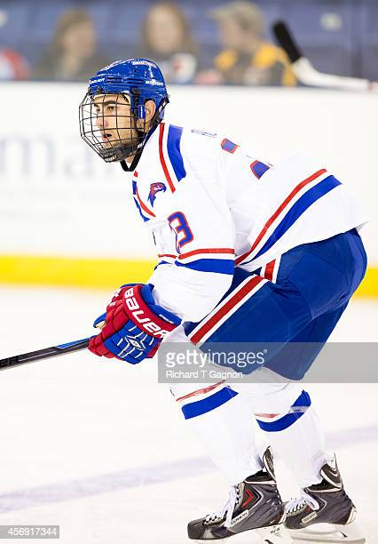 Michael Fallon of the Massachusetts Lowell River Hawks skates against the St. Thomas University Tommies during NCAA exhibition hockey at the Tsongas...