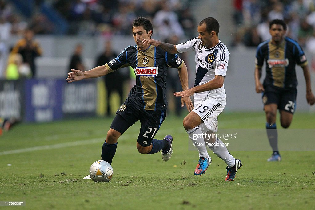 Michael Farfan #21 if the Philadelphia Union vies for position to the ball against Juninho #19 of the Los Angeles Galaxy in the first half during the MLS match at The Home Depot Center on July 4, 2012 in Carson, California. The Union defeated the Galaxy 2-1.
