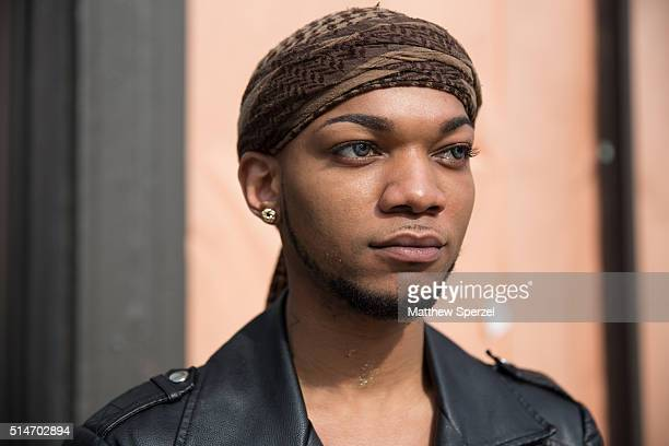 Michael Farmer is seen on Milwaukee Avenue wearing a locally sourced in Somalia turban HM black leather jacket and blue denim jeans and black/gold...
