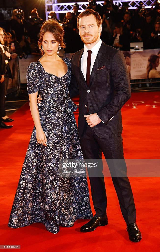 Michael Fassbender (R) and Alicia Vikander attend the UK Premiere of 'The Light Between Oceans' at The Curzon Mayfair on October 19, 2016 in London, England.
