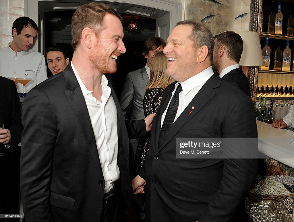 Michael Fassbender (L) and Harvey Weinstein attends The Weinstein Company and Entertainment Film Distributors Post-BAFTA Party hosted by Chopard and Grey Goose at LouLou's on February 10, 2013 in London, England.