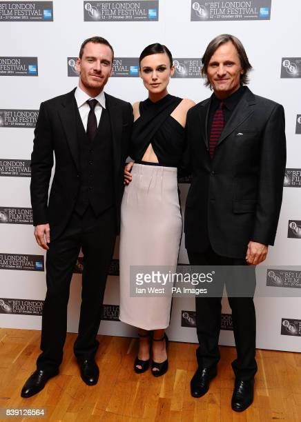 Michael Fassbender Keira Knightley and Viggo Mortensen arrive at the premiere of A Dangerous Method at the Odeon West End Cinema London