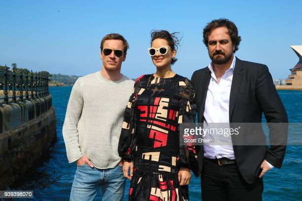 Michael Fassbender Marion Cotillard Denis Menochet pose in front of the Sydney Opera House to promote Assassin's Creed on November 11 2016 in Sydney...