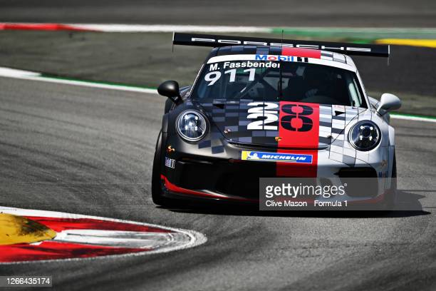 Michael Fassbender of Ireland and Porsche Motorsport drives on track during qualifying for the Porsche Mobil 1 Supercup at Circuit de...