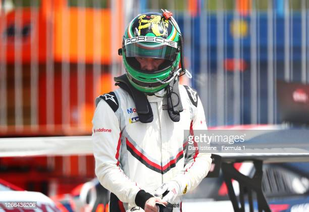 Michael Fassbender of Ireland and Porsche Motorsport gets out of his car after qualifying for the Porsche Mobil 1 Supercup at Circuit de...