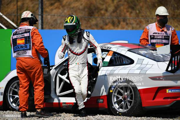 Michael Fassbender of Ireland and Porsche Motorsport leaves his car after retiring during the Porsche Mobil 1 Supercup at Circuit de...