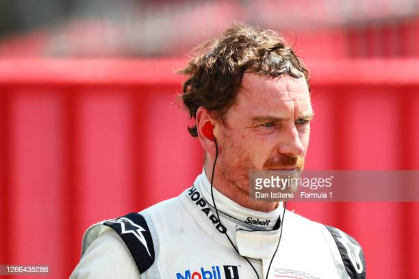 Michael Fassbender of Ireland and Porsche Motorsport looks on after qualifying for the Porsche Mobil 1 Supercup at Circuit de Barcelona-Catalunya on...