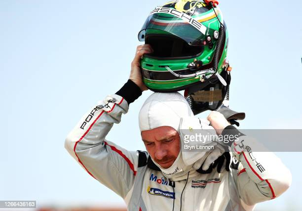 Michael Fassbender of Ireland and Porsche Motorsport removes his helmet after qualifying for the Porsche Mobil 1 Supercup at Circuit de...