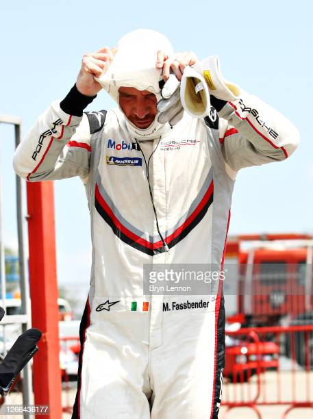 Michael Fassbender of Ireland and Porsche Motorsport removes his balaclava after qualifying for the Porsche Mobil 1 Supercup at Circuit de...