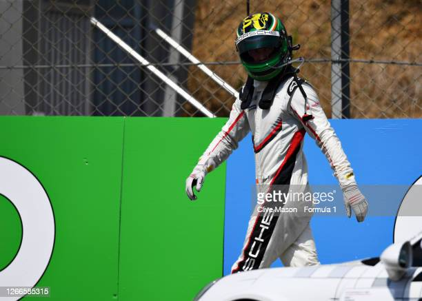 Michael Fassbender of Ireland and Porsche Motorsport walks from the track after retiring during the Porsche Mobil 1 Supercup at Circuit de...