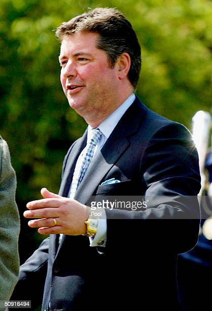 Michael Fawcett talks during The Prince of Wales' garden party at the Palace of Holyroodhouse on June 1 2004 in Edinburgh Scotland