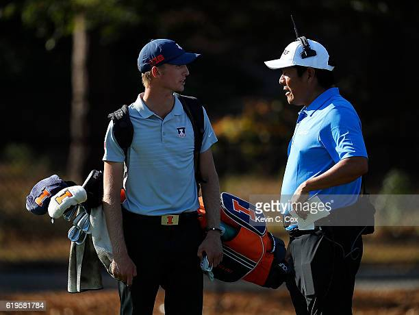 Michael Feagles of Illinois converses with Tv commentator Notah Begay III on the 13th hole during day 1 of the 2016 East Lake Cup at East Lake Golf...