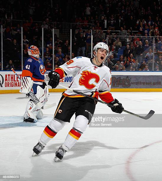 Michael Ferland of the Calgary Flames reacts after missing a penalty shot against Jaroslav Halak of the New York Islanders during the first period at...