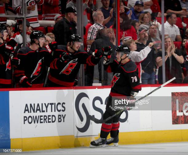 Michael Ferland of the Carolina Hurricanes is congratulated by teammates after scoring a goal during an NHL game against the New York Rangers on...