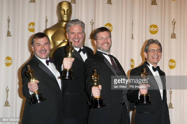 Michael Fink Bill Westnhofer Ben Morris and Trevor Wood with the award for Achievement in Visual Effects received for The GOlden Compass at the 80th...