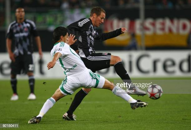 Michael Fink of Besiktas is challenged by Josue of Wolfsburg during the UEFA Champions League Group B match between VfL Wolfsburg and Besiktas...
