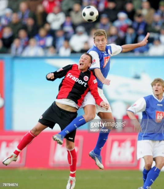Michael Fink of Frankfurt and Christian Rahn of Rostock jump for a header during the Bundesliga match between Hansa Rostock and Eintracht Frankfurt...