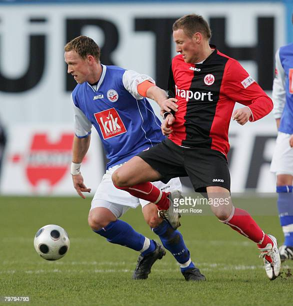 Michael Fink of Frankfurt and Enrico Kern of Rostock compete for the ball during the Bundesliga match between Hansa Rostock and Eintracht Frankfurt...