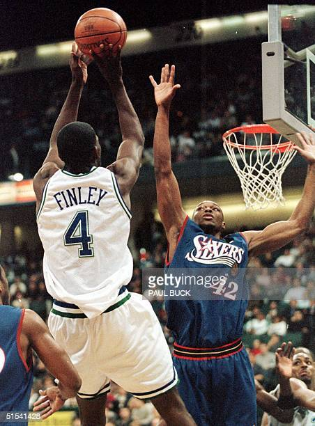 Michael Finley of the Dallas Mavericks puts up a shot over Theo Ratliff of the Philadelphia 76ers in the first half of play at Reunion Arena in...
