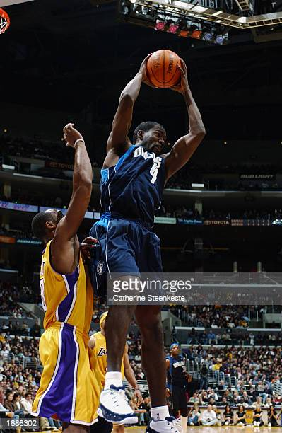 Michael Finley of the Dallas Mavericks rebounds over Kobe Bryant of the Los Angeles Lakers during the NBA game at Staples Center on December 6, 2002...