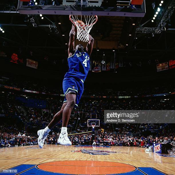 Michael Finley of the Dallas Mavericks soars for a dunk during the 1997 Nestle Crunch Slam Dunk Contest on February 8 1997 at the Gund Arena in...