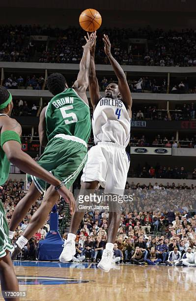 Michael Finley of the Dallas Mavericks takes a fallaway jump shot over Kedrick Brown of the Boston Celtics during the game at American Airlines...